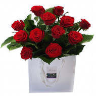 Red Roses In Craft Paper Bag